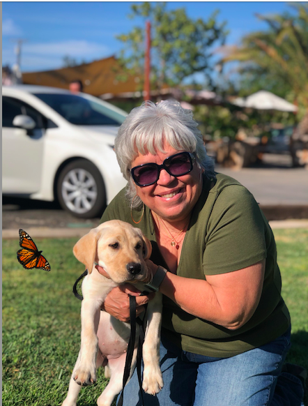 woman with puppy and butterfly outdoors