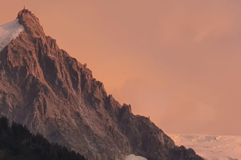Sunrise over Chamonix after running through the night