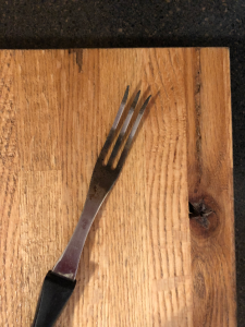 well used cooking fork