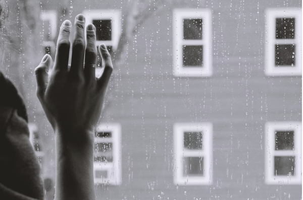hand on rainy window